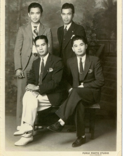 "Filipinos dressed up for photos headed back home, in order to send the message ""Doing well here in California!"" Filipinos dressed up for photos headed back home, in order to send the message ""Doing well here in California!"" (Courtesy: Filipino American National Historical Society)"