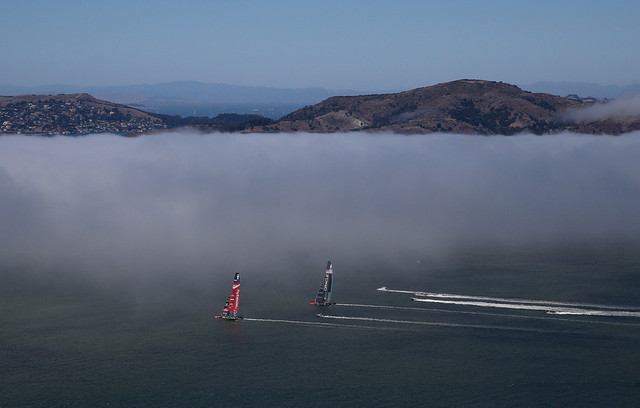 Emirates Team New Zealand (red wing) duels Oracle Team USA in America's Cup action on San Francisco Bay on Sunday. (Justin Sullivan/Getty Images)
