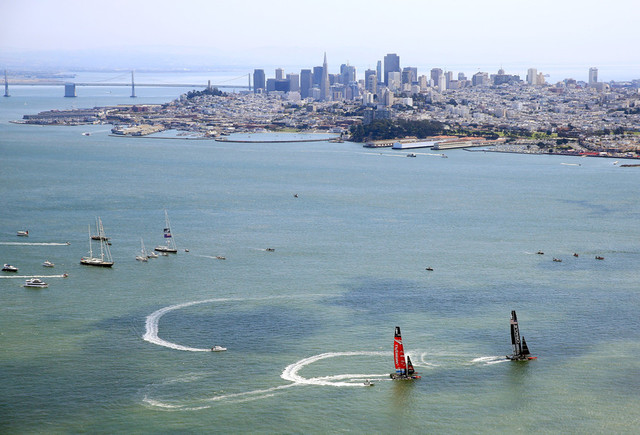 Emirates Team New Zealand and Oracle Team USA in pre-race maneuvers on Tuesday. (Jamie Squire/Getty Images)