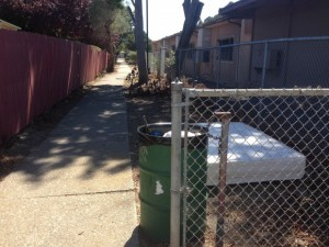 A mattress is dumped in an alley beside Stege Elementary School. (Richmond Confidential)