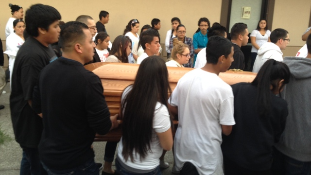 Pallbearers, many of whom were classmates of Andy Lopez, carry the casket at his funeral. (Rachel Dornhelm / KQED)