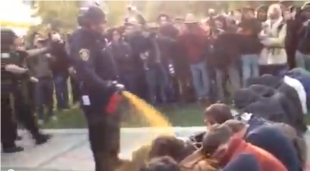 Screen shot from video of UC Davis Police Lt. John Pike pepper-spraying students during a campus Occupy protest in 2011.