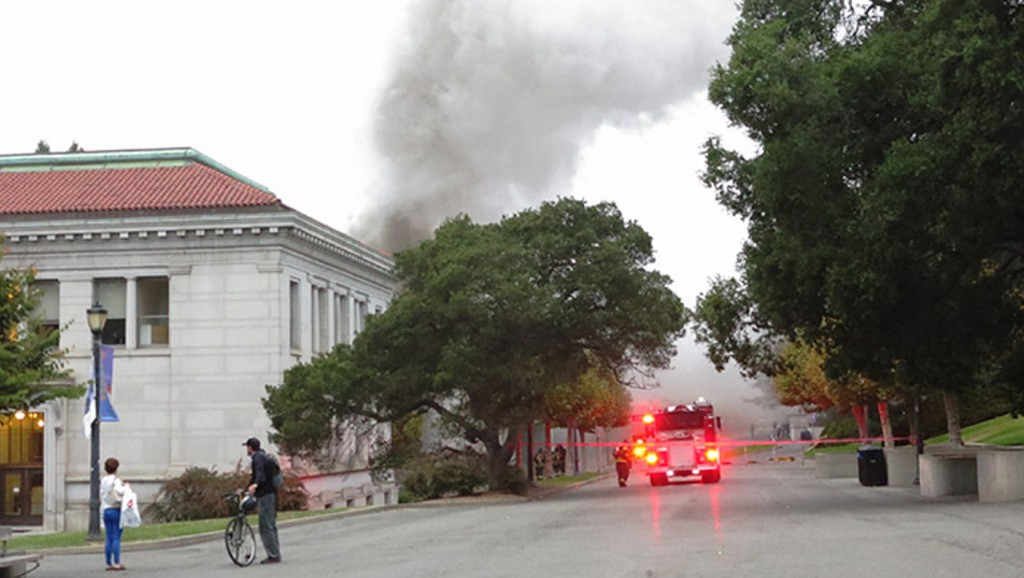 A cloud of smoke rises near Durant and California halls on the UC Berkeley campus late Monday afternoon (David Yee via Berkeleyside).