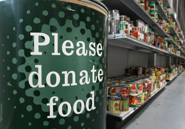 A donation bin sits near shelves with canned foods at the San Francisco Food Bank in 2008. (Justin Sullivan/Getty Images)