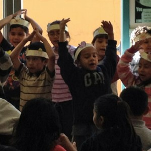 "First grade Mission Education Center students sang ""I Am A Turkey"" as part of the Thanksgiving festivities. (Katrina Schwartz/KQED)"