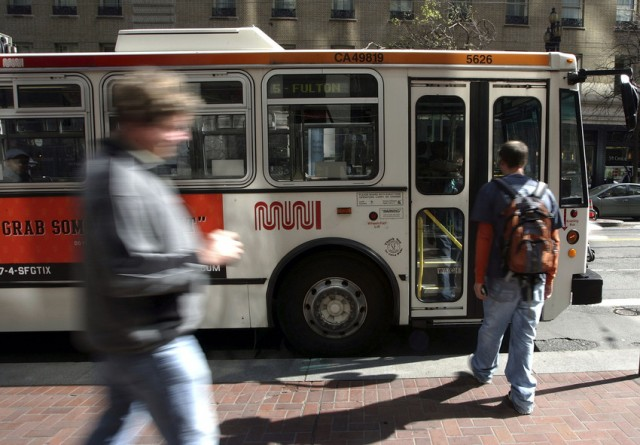 Boarding Muni's 5-Fulton on Market Street. (Justin Sullivan/Getty Images)