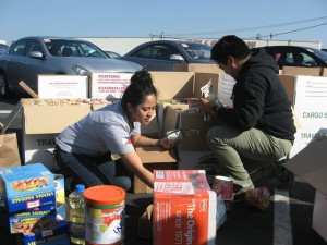Volunteers with Project PEARLS pack donated food and supplies to send to victims of Typhoon Haiyan in the Philippines. (Nina Thorsen/KQED)