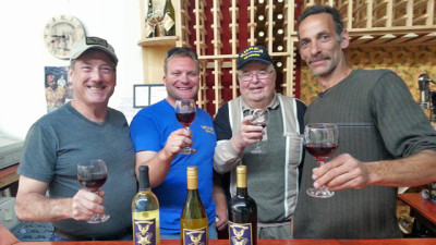 Veterans from the Korean War to those who served in Iraq and Afghanistan work at Valor Winery in Livermore, CA. From left to right: Patrick O'Connor, Josh Laine, George Laine and Gordon Yardy. (Aarti Shahani/KQED)