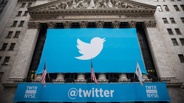 A Twitter banner hung outside the New York Stock Exchange when Twitter debuted its stock on November 7. (Andrew Burton/Getty Images)
