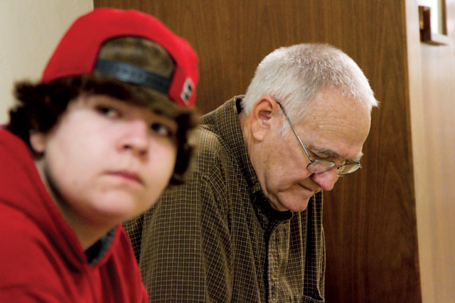 Robert Watts' son, Nicky, and father, Tom, wait before his hearing. (Gregory Cook/KQED)