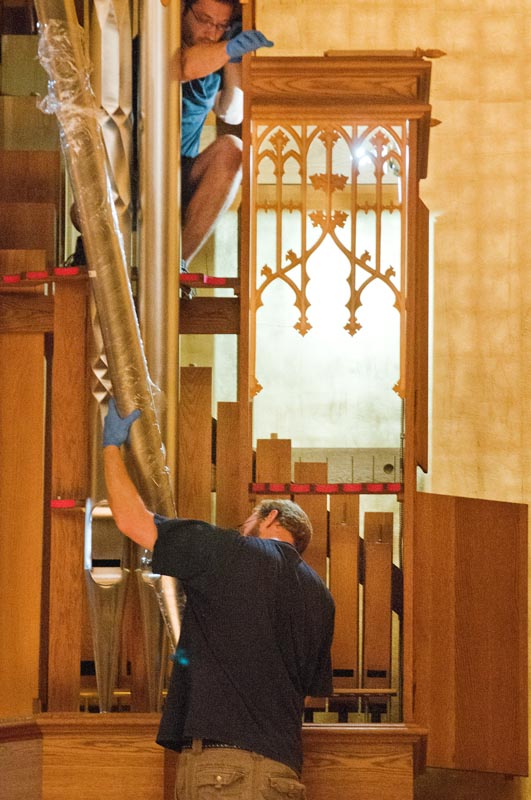 "Workers install the Noack organ's ""dutch metal"" gold leaf walls; and load-in organ parts for assembly on July 29, 2013."
