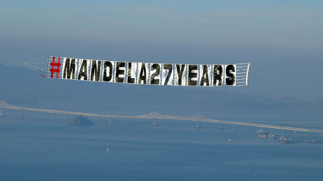 "Five ""Red Tail"" pilots flew over the Bay Area Saturday in a tribute to Nelson Mandela. (Tawanda Kanhema)"