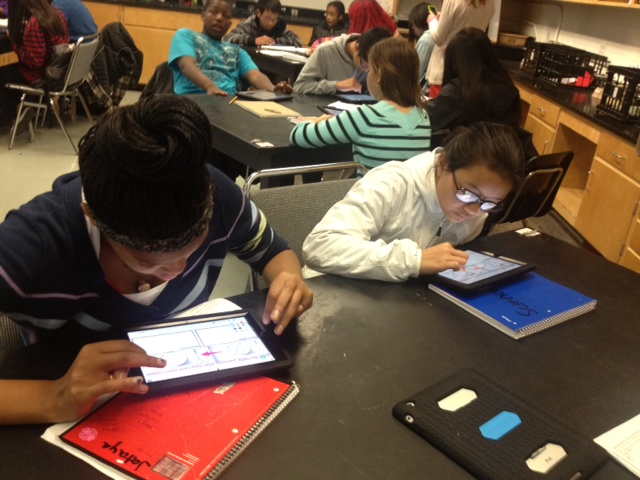 Students at Martin Luther King Jr. Middle School in San Francisco complete a science assignment using iPads. (Ana Tintocalis / KQED)