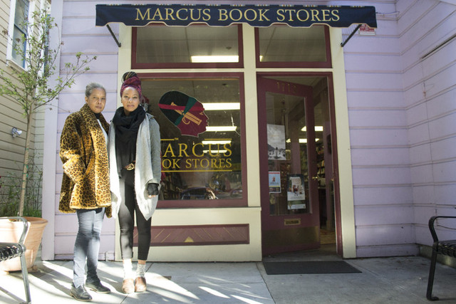 Marcus Books owner Karen Johnson and her daughter Tamiko Johnson in front of their store. (Sara Bloomberg/KQED)