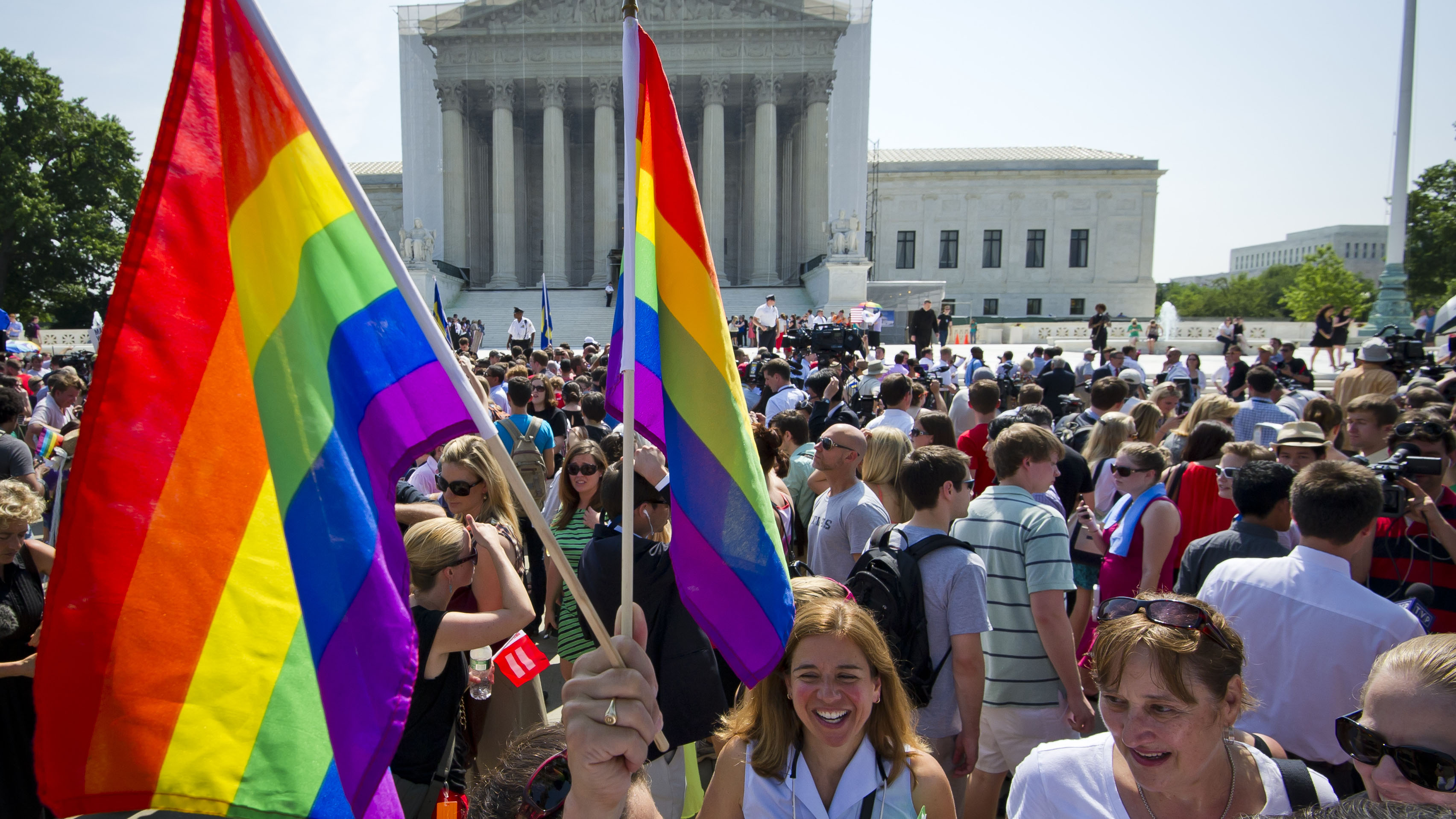 Gay rights activists gather outside the U.S. Supreme Court building on June 26, 2013.