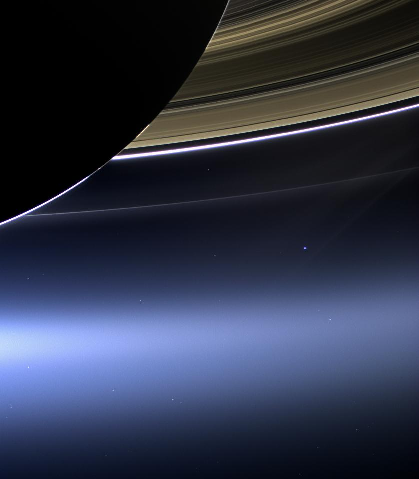 A view of Saturn and its rings with a distant Earth--the bright blue dot at lower right--in the background. (NASA/ESA)