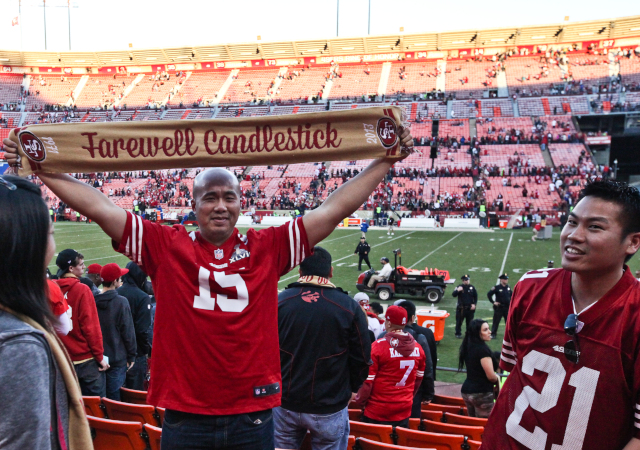 On Monday, the San Francisco 49ers will play their last regular-season game at Candlestick Park. Dennis Hui, from San Francisco, holds up a scarf that fans were given after one of the final games at the stadium. He says he's sad Candlestick park will be gone. (Deborah Svoboda/KQED)