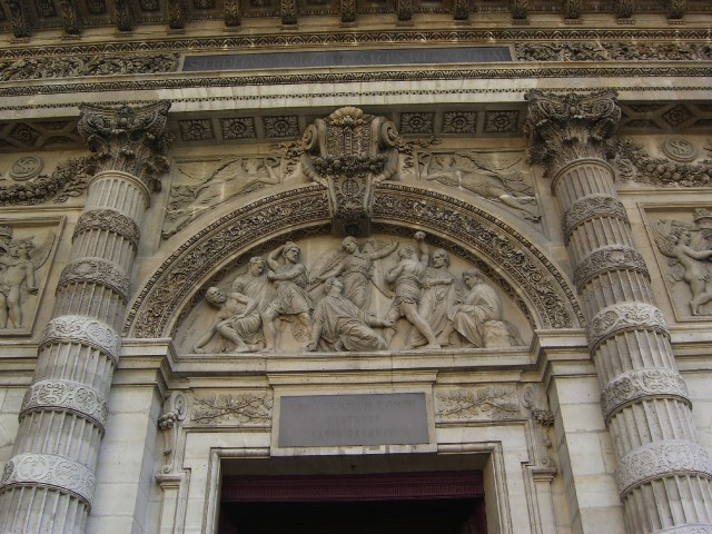 Tne entrance to Paris's Church of St. Etienne (aka St. Stephen) and St. Genevieve, depicting martyrdom of  St. Stephen.