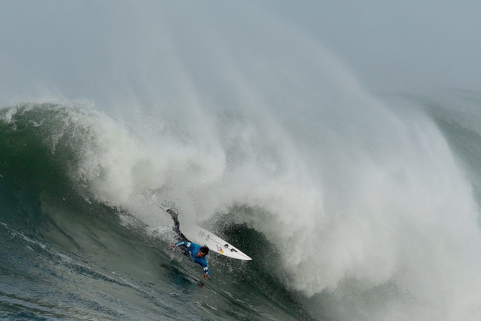 Carlos Burle takes a header  during an early heat in today's Mavericks Invitational in Half Moon Bay, California. (Ezra Shaw/Getty Images)