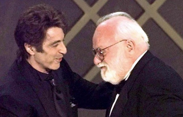 "Actor Al Pacino, left, congratulates film producer Saul Zaentz during 1997 Oscar ceremony in Los Angeles after Zaentz' film ""The English Patient"" was named best picture. (Timothy A. Clary/AFP-Getty Images)"