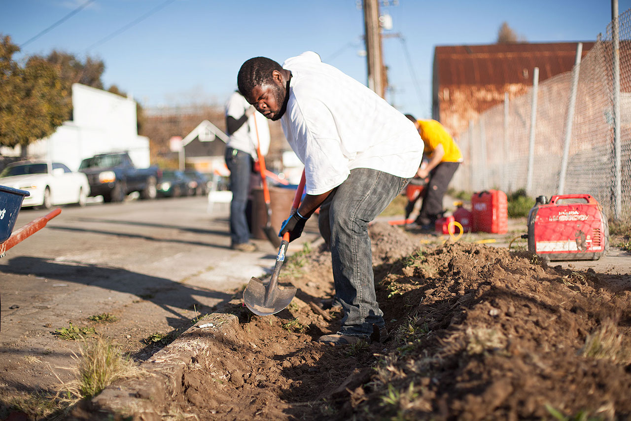 "Richmond resident Stacey Marshall was hard at work digging holes for trees next to Richmond Greenway. ""Everybody's got to try to better their community sometimes,"" Marshall said. ""I don't mind volunteering."""