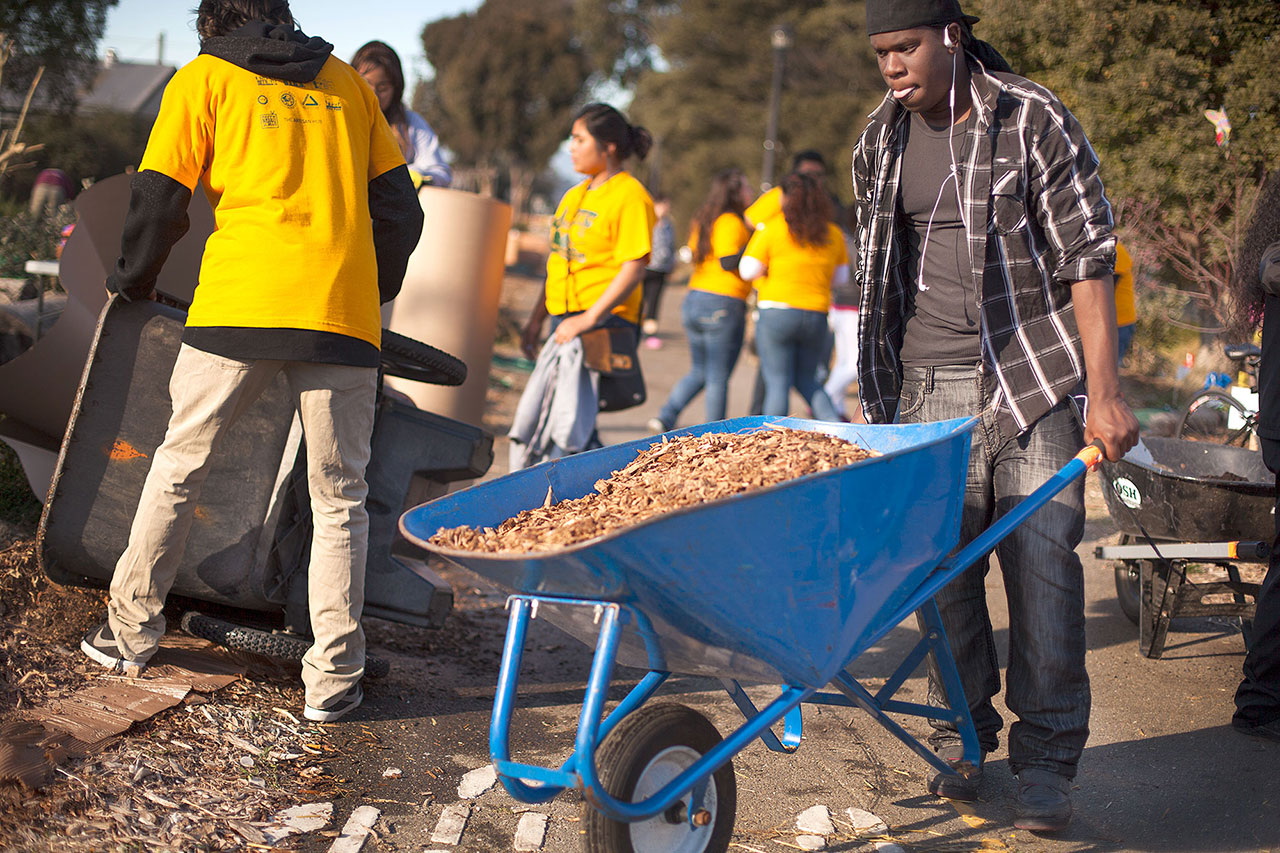 Richmond resident Shaquwann Williams, a senior at Gompers Continuation High School, pitched in by spreading mulch.
