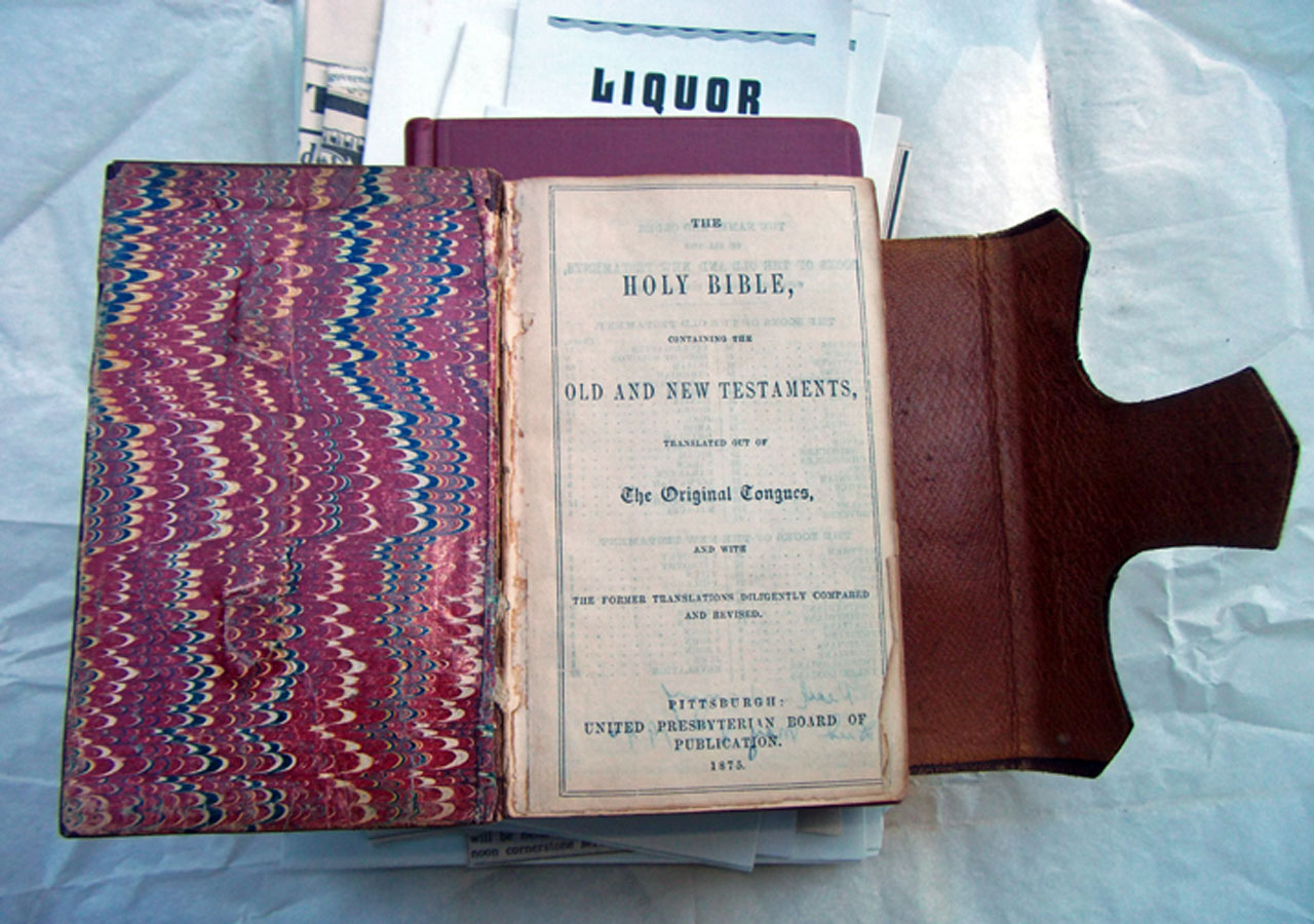 A time capsule discovered last week during the demolition of a Berkeley community church included a carefully wrapped 1875 family bible from one of the church's founding members, as well as pro-temperance fliers written by the pastor. (Leonard Nielson / Berkeleyside)