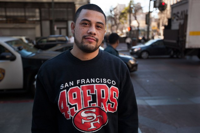 "Jayson Gazo, from San Francisco's Bayshore neighborhood, is hoping the 49ers are able to make another Super Bowl appearance this year. He's bullish on the 49ers chances to get back to the Super Bowl, thanks to second-year quarterback Colin Kaepernick. ""I don't think they could mess with Kaepernick -- the way he runs the ball and all that. Yeah, the Seahawks don't have a chance."" (Mark Andrew Boyer/KQED)"