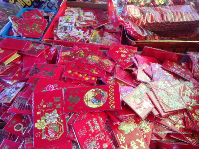 The color red, which symbolizes good fortune and happiness, is ubiquitous during the 15-day Lunar New Year celebration. (Patricia Yollin/KQED)