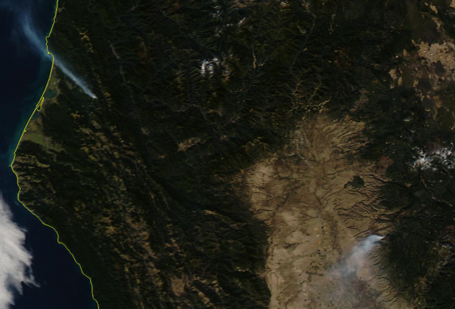 A NASA satellite image shows fires burning over the weekend in Humboldt County (left) and Tehama County (right). (NASA/University of Wisconsin)