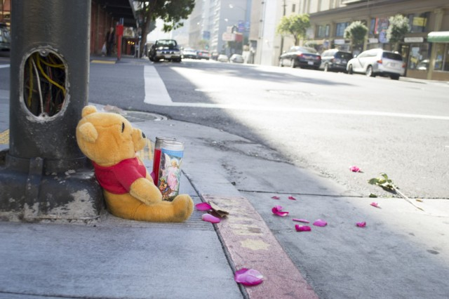 A memorial at the intersection of Polk and Ellis streets in San Francisco, where a 6-year-old girl was struck by a car and killed on New Year's Eve. (Sara Bloomberg/KQED)