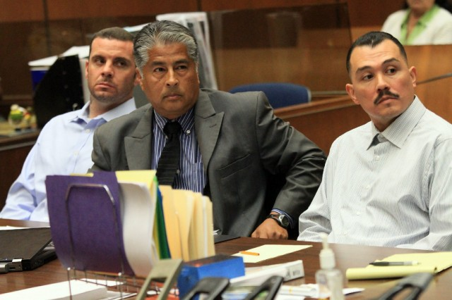 Suspects Marvin Norwood, left, and Louie Sanchez, right, with attorney Victor Escobedo during 2012 preliminary hearing on charges they attacked Giants fan Bryan Stow at Dodger Stadium. (Getty Images)