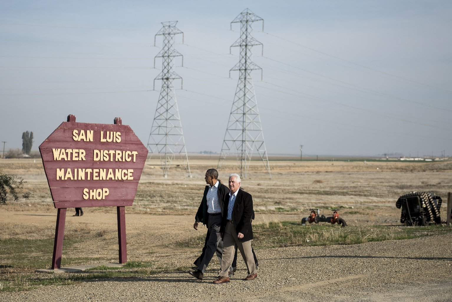 US President Barack Obama (L) and Rep. Jim Costa (D-CA) walk to a meeting with locals at the San Luis Water Facility February 14, 2014 in Firebaugh, California. (Brendan Smialowski/AFP/Getty Images)
