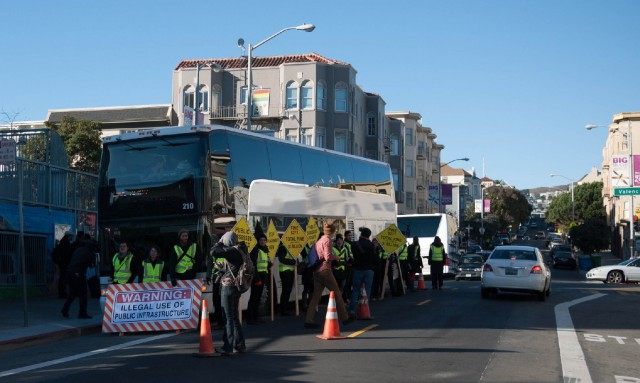 Activists surround a Google bus in a December 2013 protest at 24th and Valencia streets. (cjmartin/Flickr)