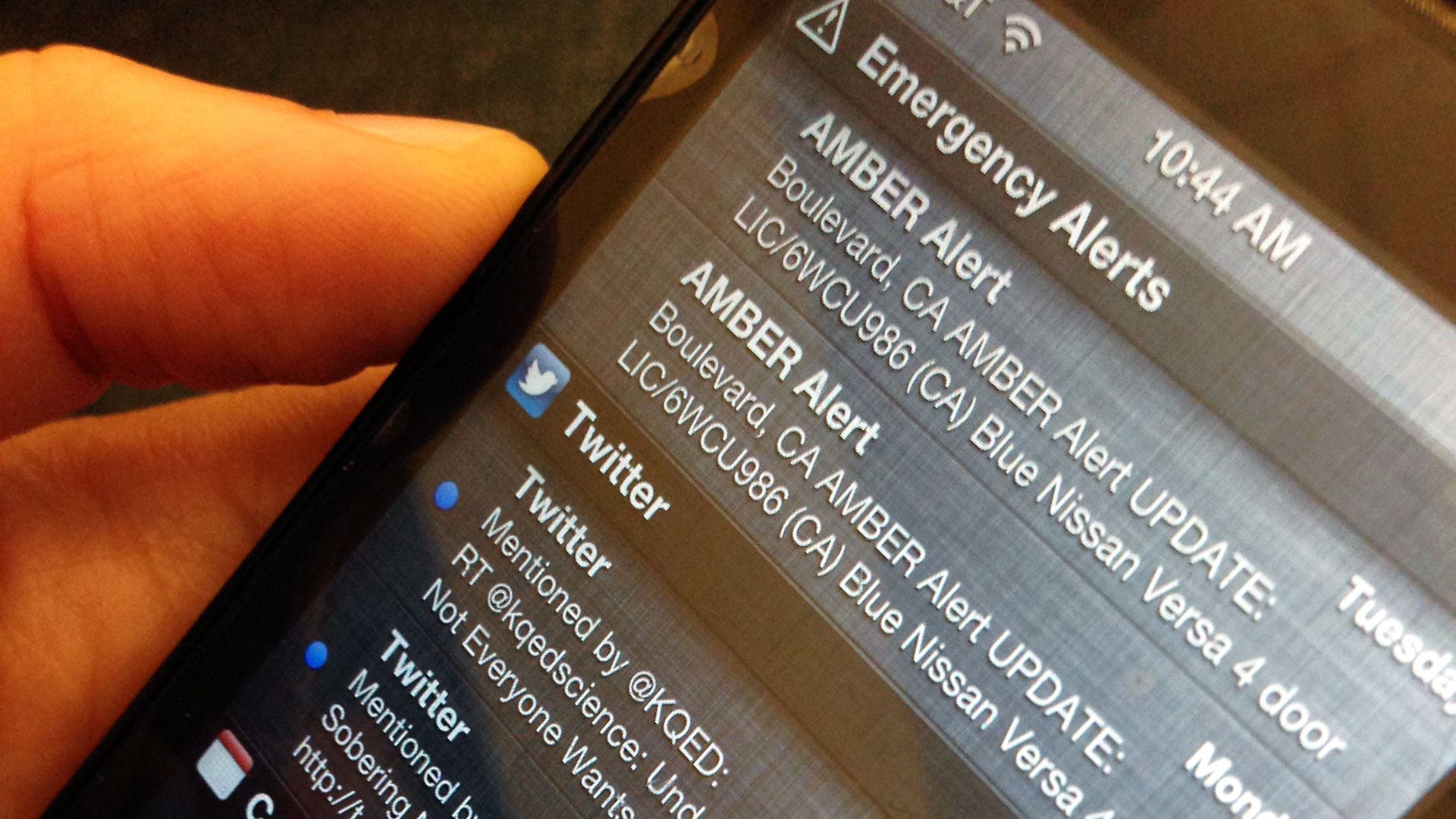 An Amber Alert appears on a smartphone.