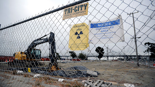 Radioactive warning signs are posted on the fence surrounding a cleanup site on Treasure Island in 2012. (Michael Short/The Center for Investigative Reporting)