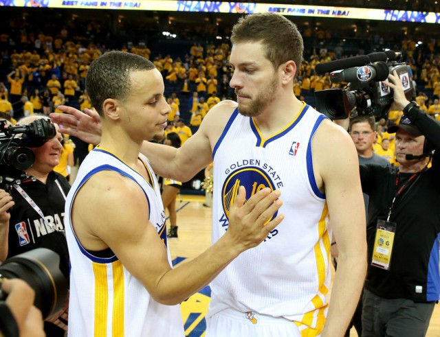 Stephen Curry #30 and David Lee #10 of the Golden State Warriors embrace after losing to the San Antonio Spurs in Game Six of the Western Conference Semifinals during the 2013 NBA Playoffs on May 16, 2013. (StephenDunn/Getty Images)
