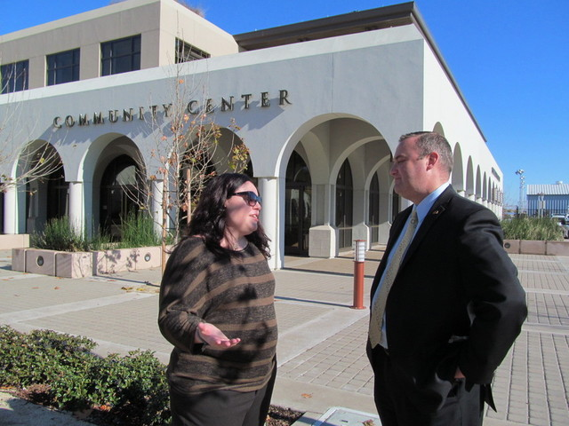 Attorney Leah Castella and Brentwood City Manager Paul Eldredge chat in front of Brentwood's Community Center. (Cyrus Musiker/KQED)