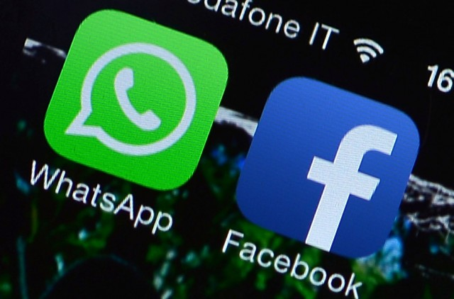 The Facebook and WhatsApp applications' icons are displayed on a smartphone on February 20, 2014. (Gabriel Bouys/AFP/Getty Images)