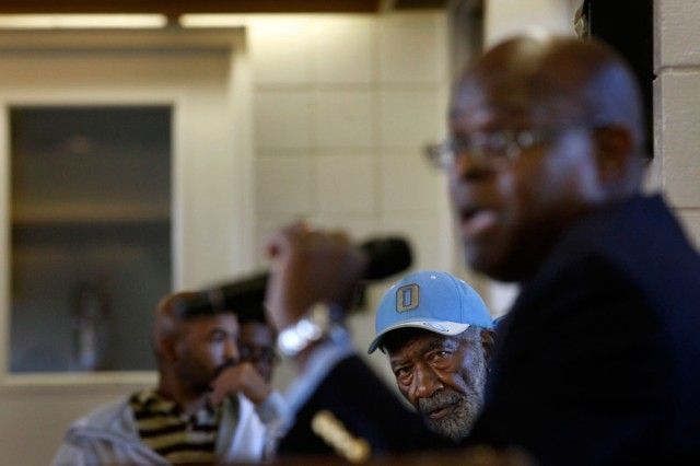 John Oliver, 76, a 10-year Nevin Plaza resident, listens as Richmond Housing Authority Executive Director Tim Jones explains issues at a Housing Advisory Commission meeting Oct. 22, 2013. Residents say their pleas for basic maintenance often are ignored by officials paid to provide services to the poor. (Lacy Atkins/San Francisco Chronicle)