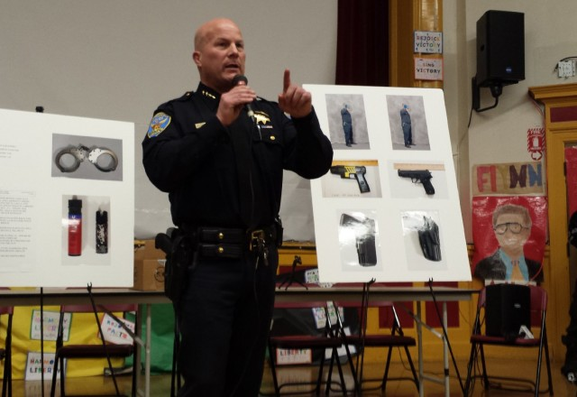 San Francisco Police Department Chief Greg Suhr addresses an angry crowd at a town hall meeting Tuesday about a recent fatal officer-involved shooting in the city's Bernal Heights Park. Suhr said officers believed 28-year-old Alejandro Nieto pointed a gun at officers from 75 feet away, but the weapon turned out to be a Taser stun gun.