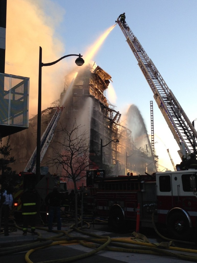 Firefighters pour water over a five-alarm fire in China Basin. (Charla Bear/KQED)