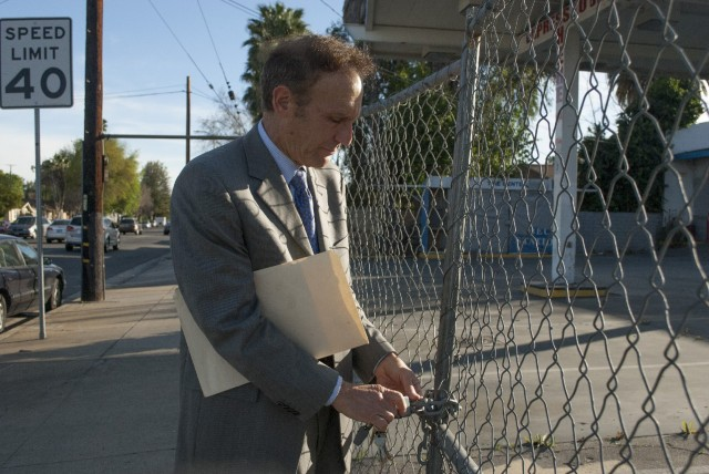 Attorney Howard Mehler says a lagging cleanup at this former gas station site has made it impossible for his client to find a suitable tenant. (Chris Richard/KQED)