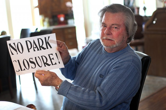 David Tripp and his neighbors printed signs to protest the closure of the Winchester Ranch mobile home park (Mark Andrew Boyer/KQED)