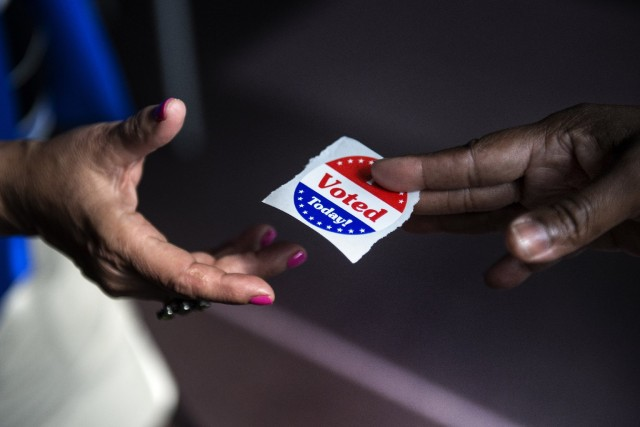More and more Californians are voting by mail, but the trend is more pronounced for Asian voters and those over 55. (Brendan Smialowski/Getty Images)