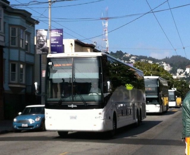 A private shuttle bus passes through San Francisco's Mission District. (David Gartner/Flickr)