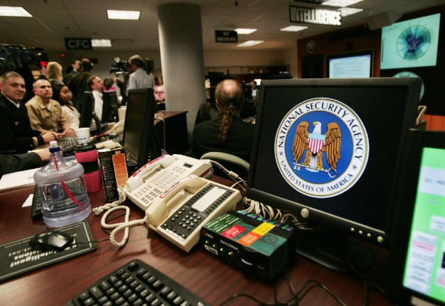 A computer workstation bears the NSA logo inside the Threat Operations Center in Fort Meade, Md. in this 2006 photo. (Paul J. Richards/AFP/Getty Images)