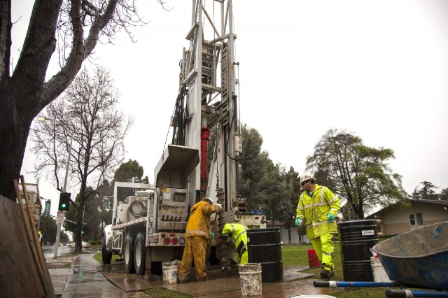 An environmental remediation crew digs a groundwater monitoring well on the property of First Presbyterian Church in Newark. (Mark Andrew Boyer/KQED)