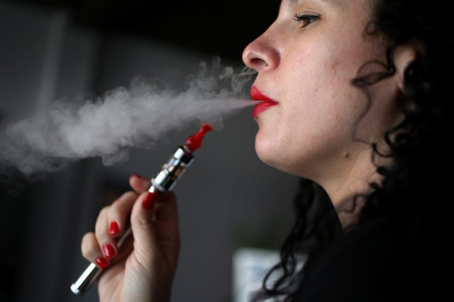 Julia Boyle enjoys an electronic cigarette at the Vapor Shark store. (Joe Raedle/Getty Images))