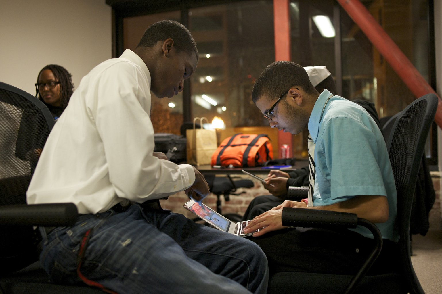 Bryon Muccular and Matthew Jones work at the Black Male Achievement hackathon in Oakland, Calif. (Jeremy Raff/KQED)